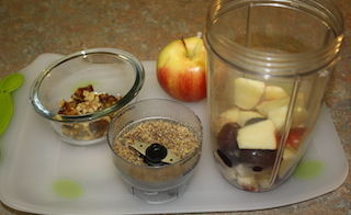 an apple, flaxseed, walnuts, dates - just some of the ingredients to make a yummy walnut topped smoothie