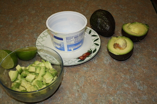 picture shows  first step in making an avocado fish salad, how to make avocado container
