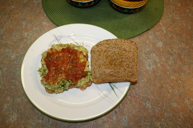 Add drained healthy salsa on top of the guacamole to make a healthy to eat sandwich