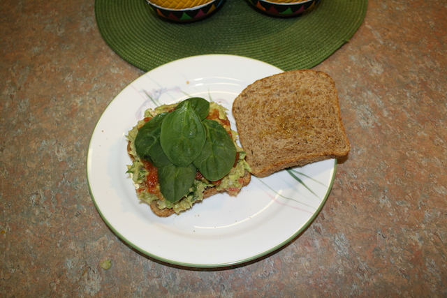 Spinach on top of the salsa makes a colorful sandwich. Kale could be used or lettuce even