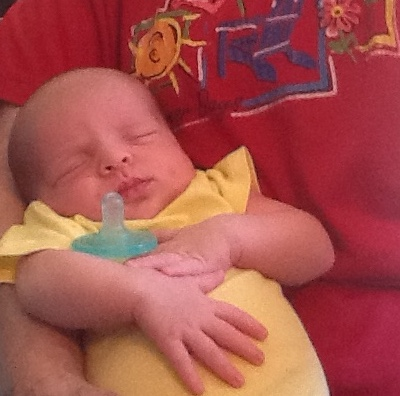 A baby can sleep well when held in a comfortable position in someones arms.