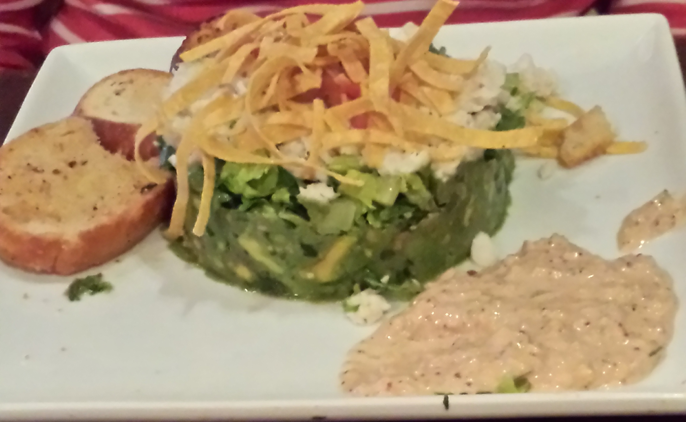 A lovely lump crab salad in an avocado base with crisp chips on top from Texas Land and Cattle