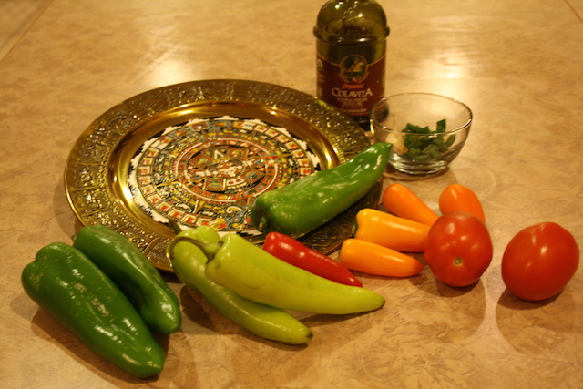 Colorful peppers on a golden decorative tray are so colorful and healthful.