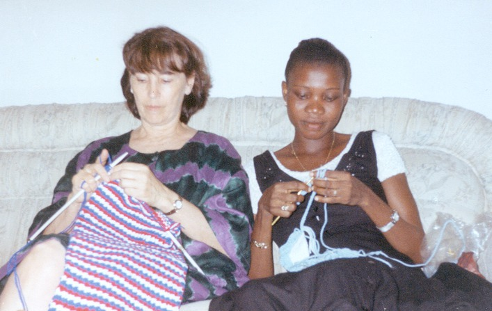 Grace learning to crochet--and doing very well