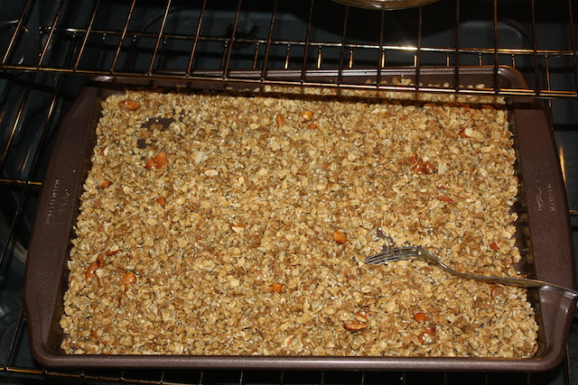 granola in the oven needs to be stirred with a fork occasionally