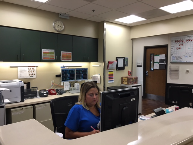Nurses keep the records up-to-date at the hospital.