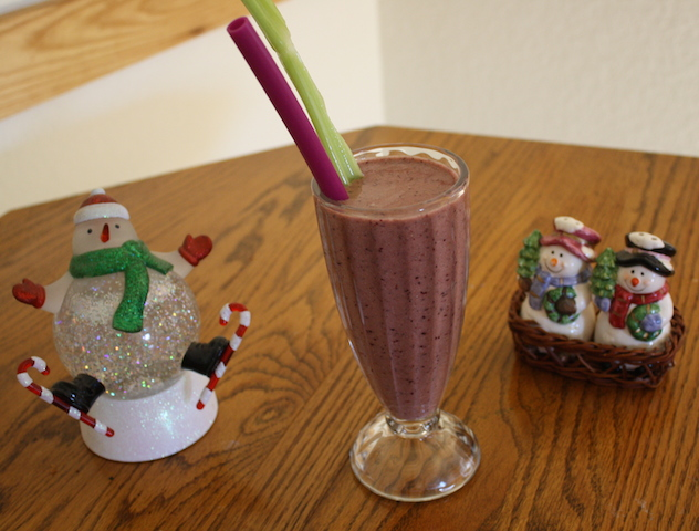 colorful pineapple berry smoothie with snowmen ceramics
