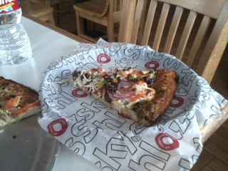 An occasional low calorie lunch in town veggie pizza is good