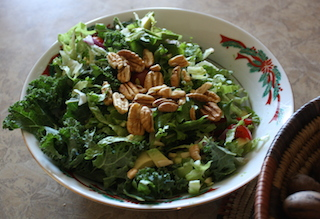 A crispy tossed salad topped with pecans