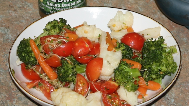 broccoli, cauliflower, and carrots lightly steamed and tossed with tomatoes.