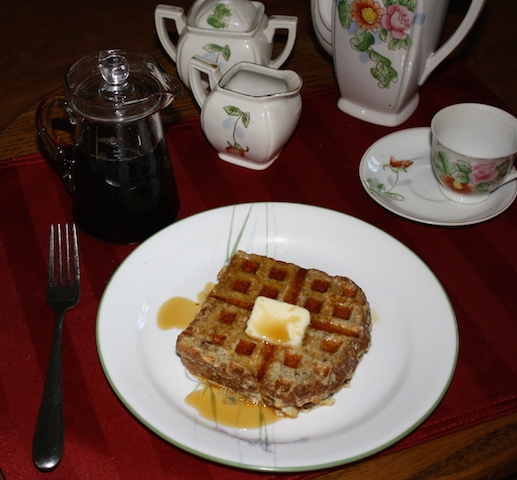 A delicious wafflette with butter and syrup