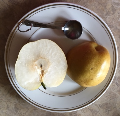 An asian pear is juicy and tasty. It is a healtlhy treat.