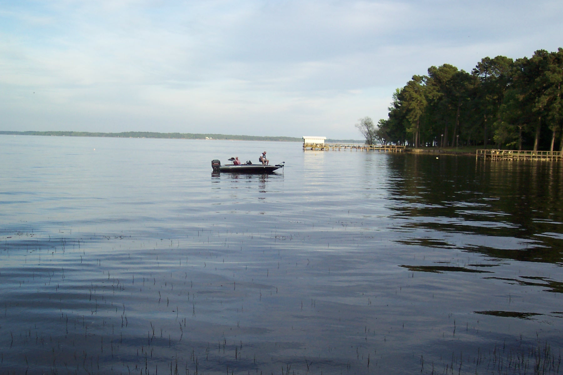 Fisherman drifting with the tide, relaxing as they cast their lines into the water