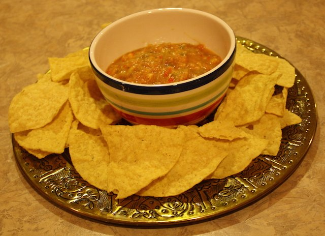 A bowlful of healthy salsa with chips makes a good appetizer or snack.